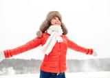 happy woman in winter fur hat outdoors - 179146341