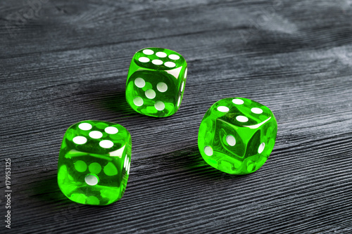 Poster risk concept - playing dice at black wooden background