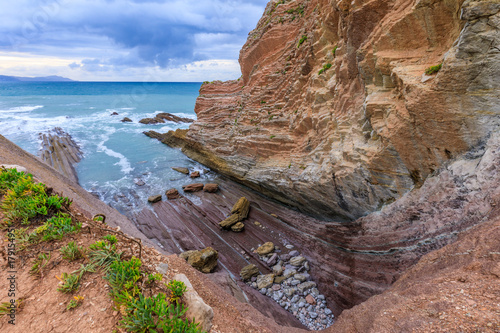 Fotobehang Zalm Flysch rock formation and beach, Spain
