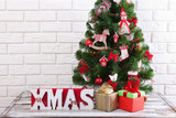 White wooden table in front of colorful christmas tree with gift boxes. Can be used for display or montage your products - 179157129