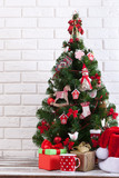 White wooden table in front of colorful christmas tree with gift boxes. Can be used for display or montage your products - 179157355
