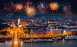 Fireworks over the Old Town in Bratislava, new bridge over Danube river with evening lights in capital city of Slovakia,Bratislava