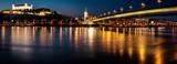 Bratislava castle,Parliament and the New bridge over Danube river with evening lights in capital city of Slovakia,Bratislava