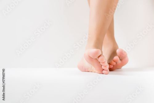 Fototapeta Barefoot. Cares about a woman's clean and soft foot skin. Body care concept.