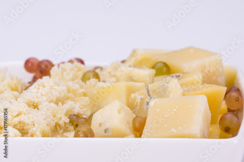 Poster Set of cheeses and grapes on a white background