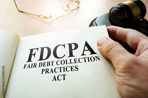 Poster Fair Debt Collection Practices Act FDCPA on a table.