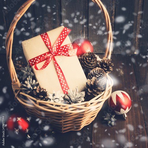 Christmas or New Year present in basket with balls and pinecones - 179177914