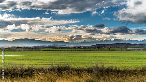 Aluminium Landschappen CountrySide Landscape with green Field and Mountains,