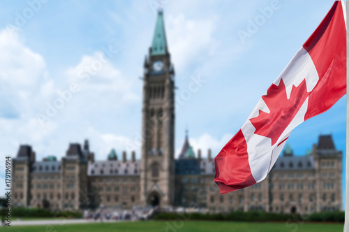 Poster Canada Canadian flag waving with Parliament Buildings hill in the background Ottawa,Ontario, Canada
