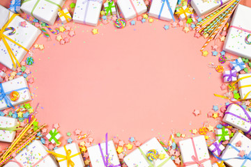 Festive gifts of pastel delicate colors on a pink background.