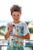 A boy with a message in a bottle. A letter in a vial found on the waves of Mediterranean sea.
