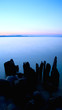 Sunset over Torch Lake shore.
