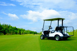 golf cart on green lawn with blue sky and cloud for background backdrop use