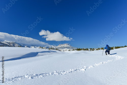 climber alone in winter Poster