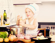 Baby girl cooking with meat - 179238589