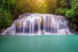 Amazing beautiful waterfalls level two in tropical forest at Erawan Waterfall in Erawan National Park, Kanchanaburi Province, Thailand