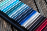 Color samples of a fabric on a wood background