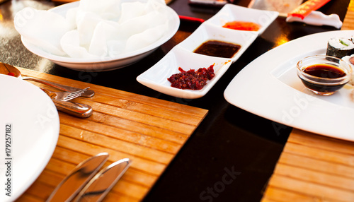 Papiers peints Sushi bar Sushi Set and sushi rolls served on wood table.