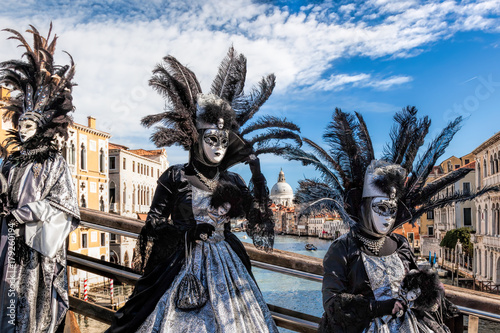 Papiers peints Venise Carnival masks on bridge against Grand Canal in Venice, Italy