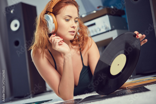 Fotobehang Muziek the image of resting sexy woman listening to vinyl