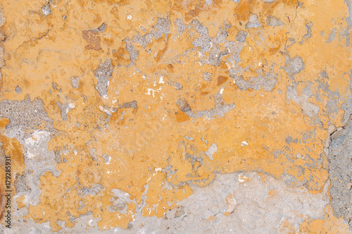 Papiers peints Beton Close view of yellow building wall cracked and broken architecture concrete texture