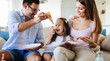 Happy family sharing pizza together at home - 179289159
