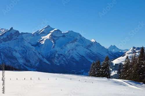 Aluminium Blauwe jeans Snow covered mount Oldenhorn. Winter scene near Gstaad, Switzerland.