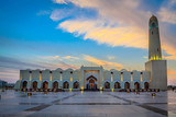 Imam Muhammad ibn Abd al-Wahhab Mosque (Qatar Grand Mosque) exterior view at sunset with clouds in the sky