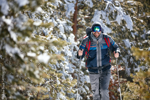 Extreme winter sports - Man hiking in the mountains