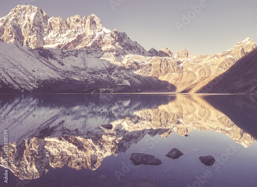 Fotobehang Beige Vintage stylized picture of mountains reflected in Gokyo Lake, Sagarmatha National Park, Nepal.