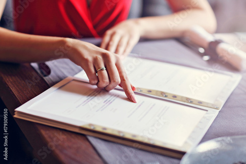 Romantic couple dating in restaurant and ordering from menu