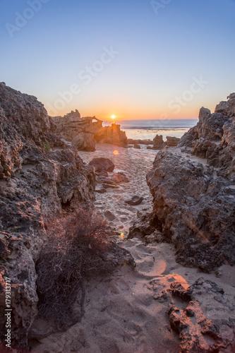 Fotobehang Diepbruine Sunrise at Rocky Beach, Australian Landscape