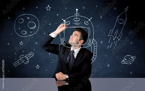Sales person drawing helmet and space rocket