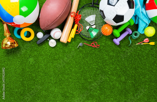 Various sport tools on grass плакат