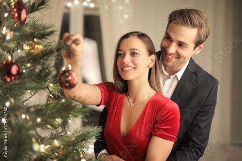 Beautiful couple making a Christmas tree