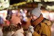 happy couple holding hands at christmas market