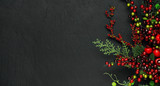 Christmas tree banches and red berries background - 179328149