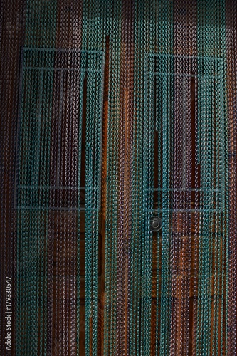 House door with colorful curtain