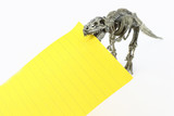 T-rex skeleton of toy bitten a yellow paper note