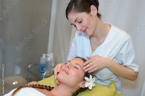 Fotobehang Spa young woman having head massage