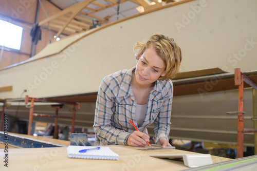 female working at her workshop - 179358507