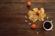 autumn coffee or tea warm maple leaf wooden surface background concept. Seasonal coziness. Disease prevention