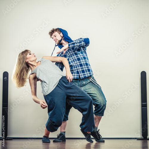 couple of young man and woman dancing hip-hop Poster