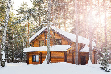 A wooden house in a winter forest