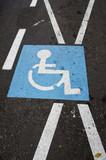 Invalid parking place sign on asphalt