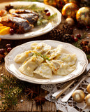 Christmas dumplings stuffed with mushroom and cabbage on a white plate. Traditional Cristmas eve dish in Poland - 179392381