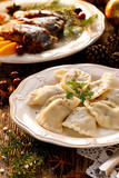 Christmas dumplings stuffed with mushroom and cabbage on a white plate. Traditional Cristmas eve dish in Poland - 179392708