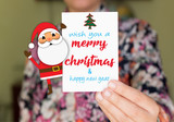 girl holding a wish card ans santa, merry christmas - 179393720