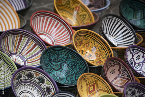 Papiers peints Maroc colorful plates & dishes in traditional painted designs on sale in a Moroccan Market