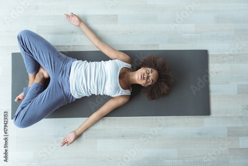 Serious lady doing exercise at home